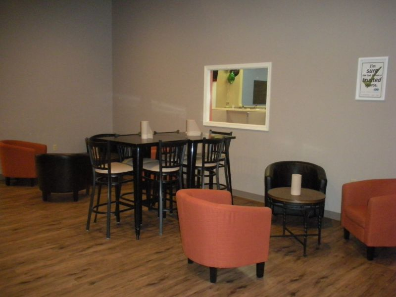 Break room with tables and chairs and food at American Customer Care Montoursville