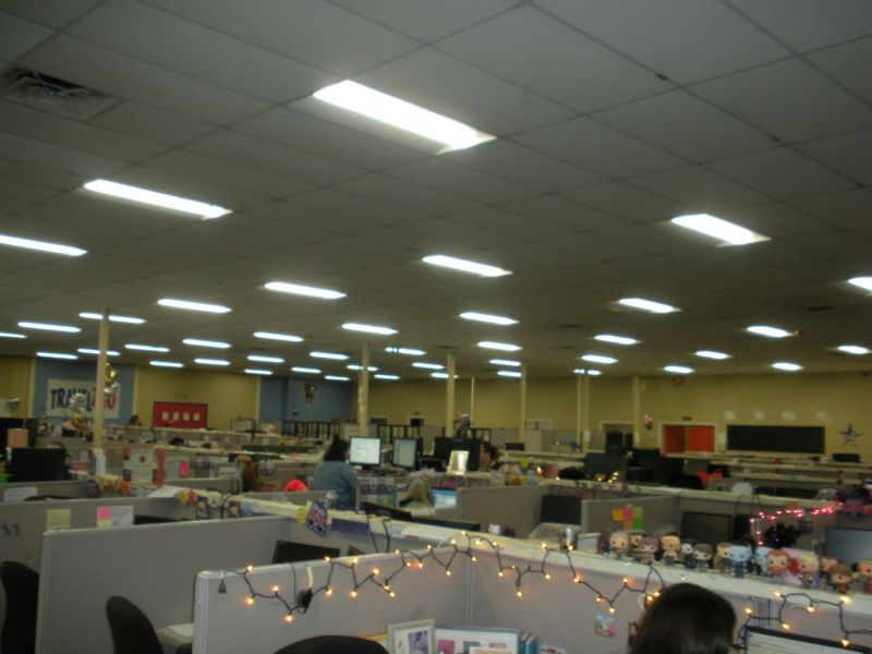 One of the call center areas with cubicles, chairs, computers and phones at American Customer Care Montoursville
