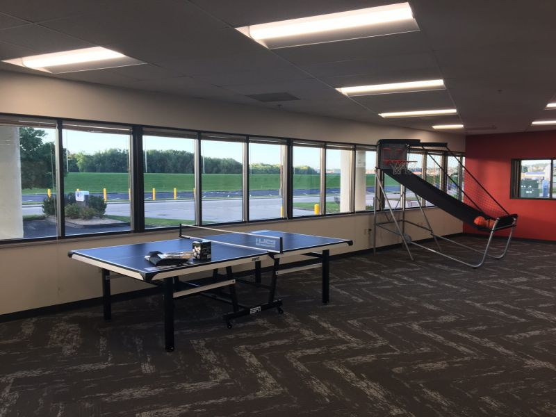 employee engagement area at American Customer Care with a ping pong table and a basketball game