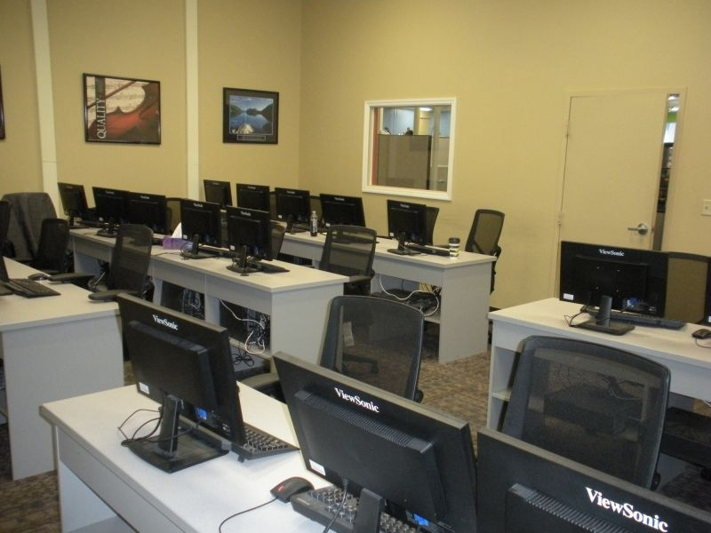 Training room with desks, chairs, computers and phones at American Customer Care Montoursville
