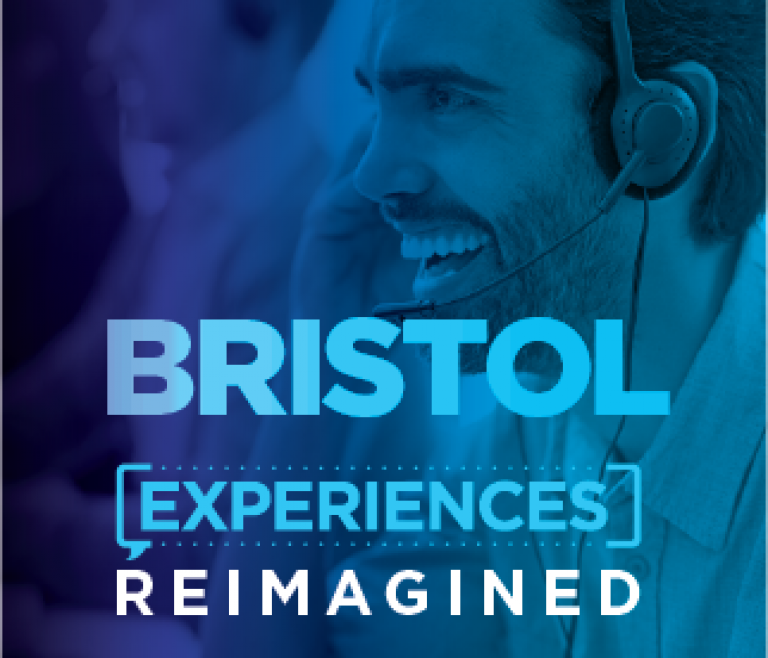 Bristol location header with a man smiling at his desk