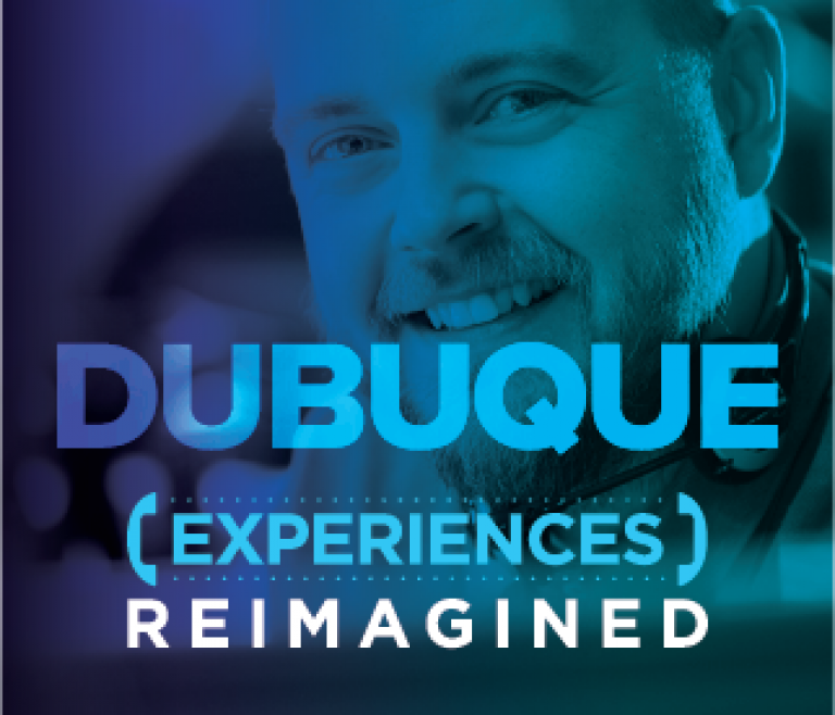 Dubuque location header with a man smiling at his desk